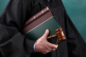 Judge, law book and gavel
